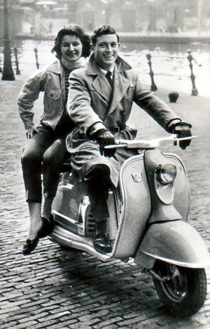 Vintage couple 1950s 1960s scooter.