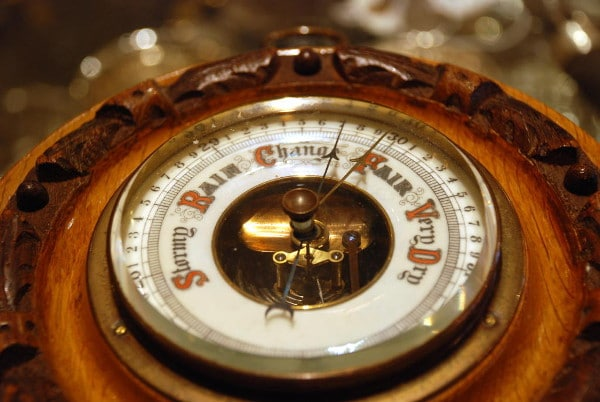 vintage aneroid barometer in wood casing