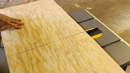 Cutting plywood with table saw.