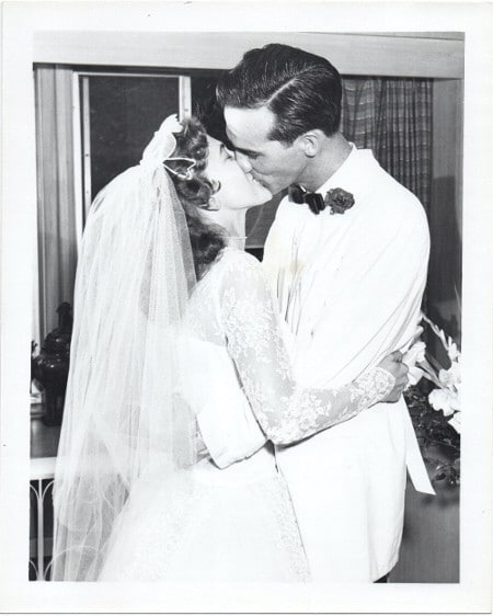 Vintage wedding couple kissing 1950s.