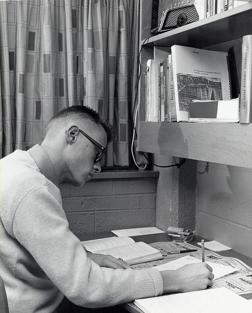vintage 1950s young man college door room studying