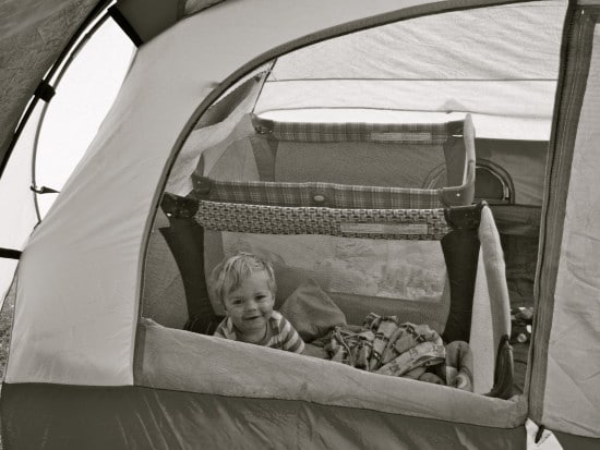 toddler in camping tent with pack n play
