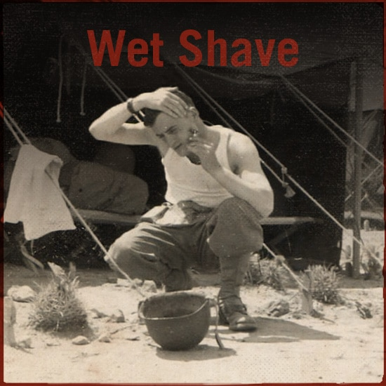 Man is shaving.