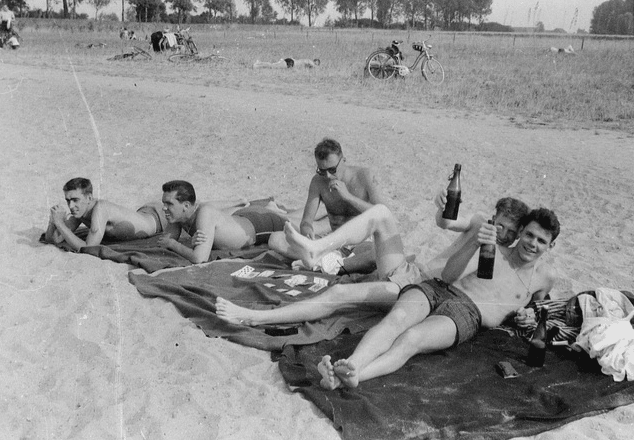 vintage 1940s men sunbathing playing cards beach