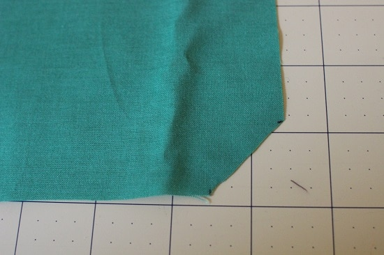 Diy pocket square cut diagonal corners in fabric.
