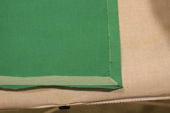 Diy pocket square applying hem tape cutting to size.