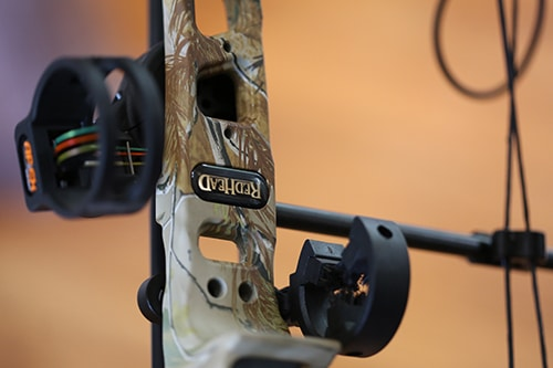 Sight and arrow rest compound bow riser.