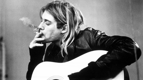 kurt cobain smoking guitar in hand black white