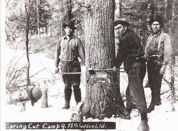 vintage lumberjacks using ax to chop tree
