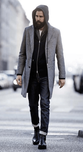 hipster wearing gray overcoat over hooded sweatshirt