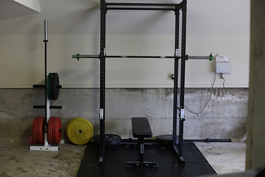 home garage gym squat rack bench weight plates