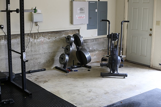 garage home gym airdyne bike and iron lifting plates