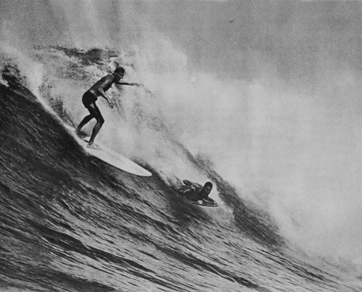vintage surfers riding big waves standing