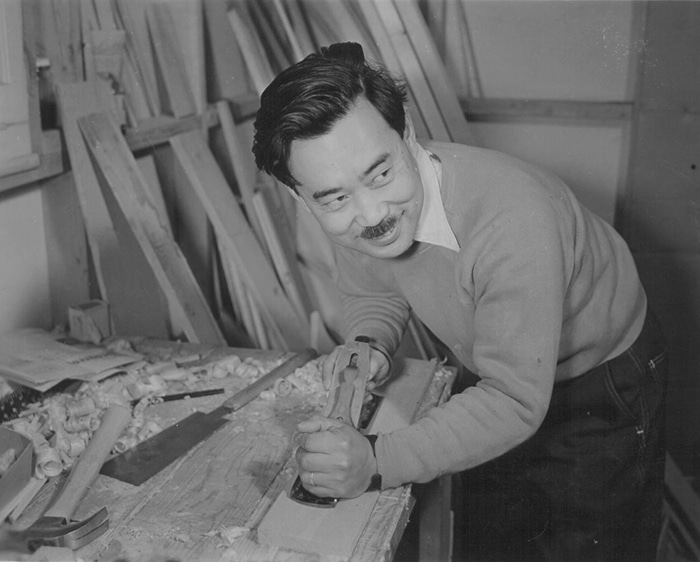vintage man asian american with wood planer mustache