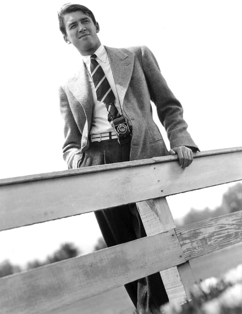 james stewart standing at fence wearing blazer