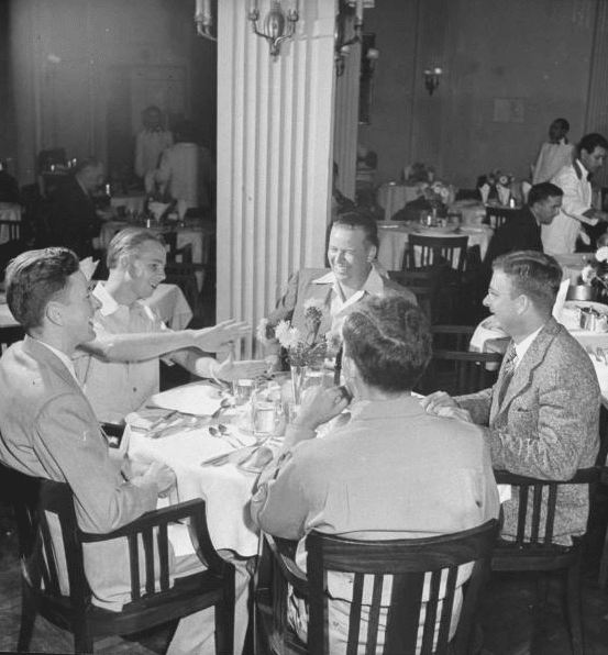 vintage group of men eating dinner dining out laughing drinking