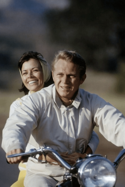 steve mcqueen on motorcyle wearing khaki harrington blouson jacket