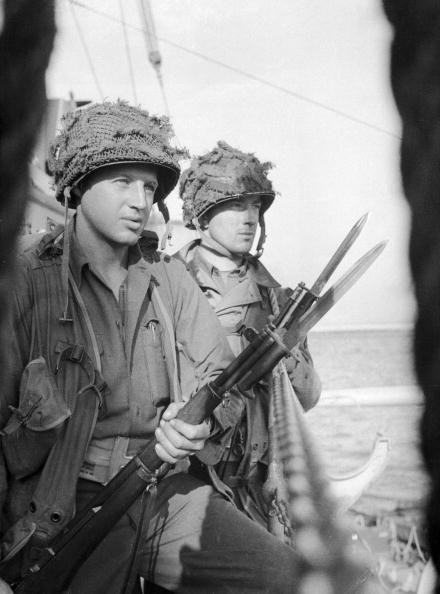 vintage soldiers in uniform with guns bayonets calm confident