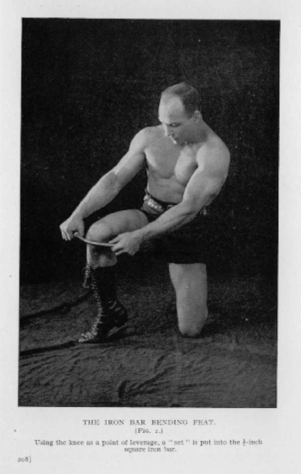 vintage oldtime strongman bodybuilder bending steel on knee