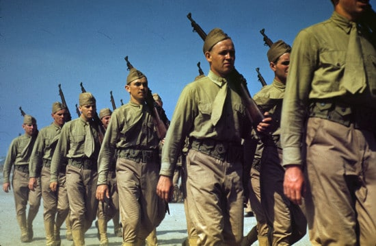 vintage marines marching in formation with guns