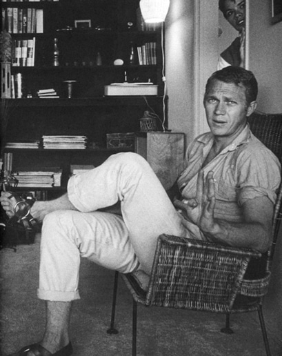 steve mcqueen sitting in chair khakis rolled up