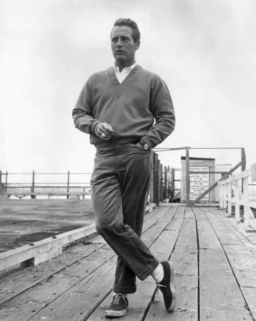 paul newman standing on dock wearing khakis sweater