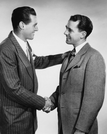 vintage businessmen shaking hands smiling making deal