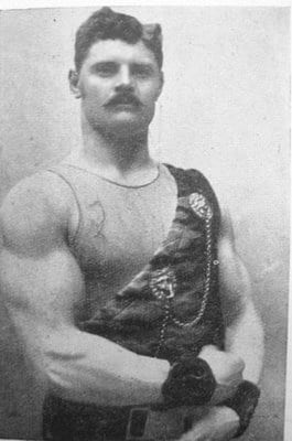 Strongman bodybuilder flexing his arms.