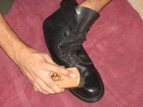 Brushing the boot.