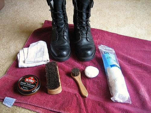 Black boots with poolishing kit.