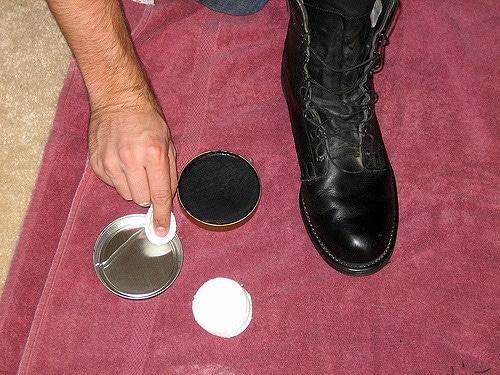 Shinning the boot.