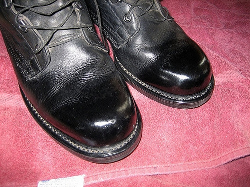 Showing the shine of black boot.