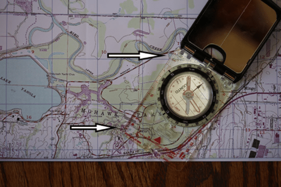 taking a bearing with map and compass