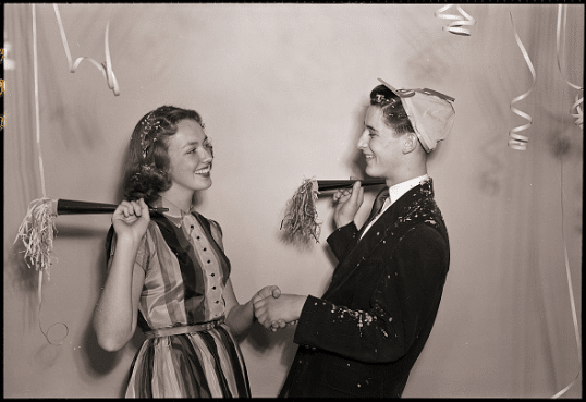 Vintage young boy and girl dancing at birthday party.