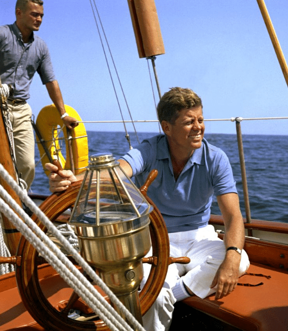 jfk john f kennedy on a sailboat smiling in wind