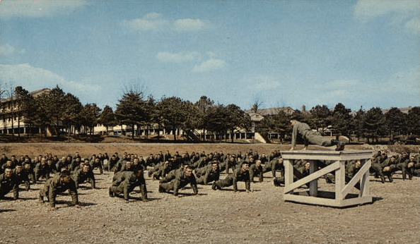 vintage army boot camp soldiers doing push ups