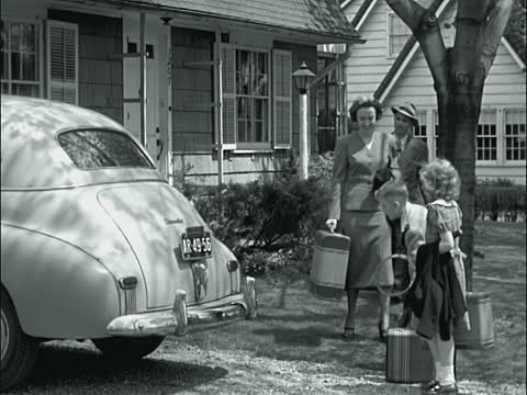 vintage family leaving house on vacation with suitcases