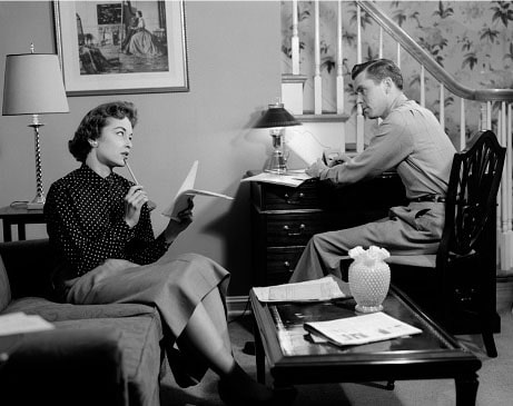 Vintage couple in living room talking meeting.