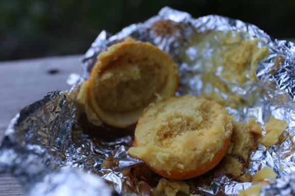 Orange peel cupcake in tin foil campfire dessert.