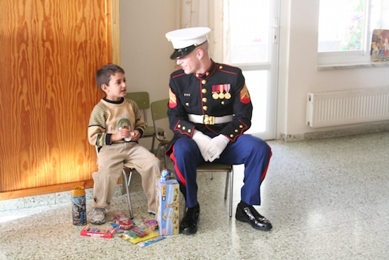 Little boy talking with Marine embassy guard.