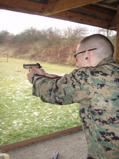 Marine shooting target practice handgun and gougles.