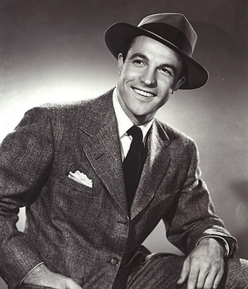 vintage man in suit and fedora smiling