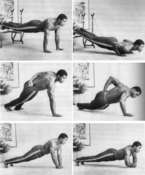 Herschel Walker push up variations working out.