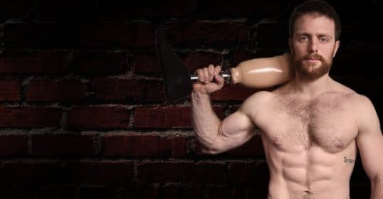 Anthony Arvanitakis holding prosthetic leg and wall as background.