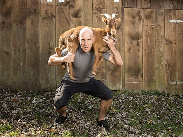 chris mcdougall writer lifting holding goat on shoulder