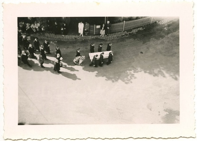 vintage funeral procession pallbearers carrying casket