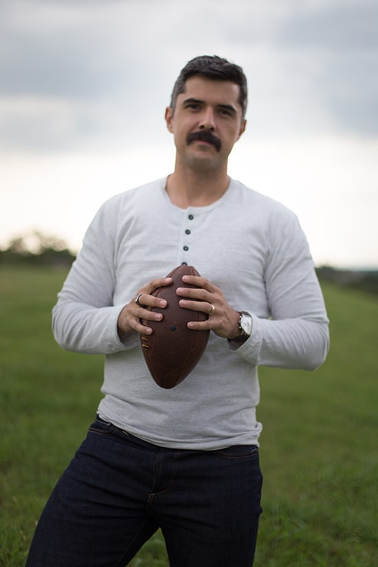 Man holding american football.