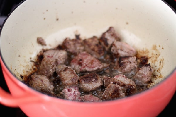 beef cubes cooking searing in dutch oven pot homemade beef stroganoff