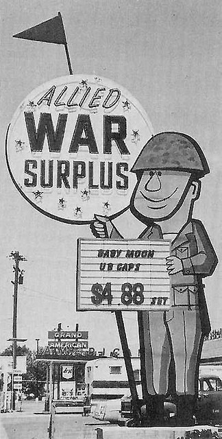vintage army navy surplus store sign