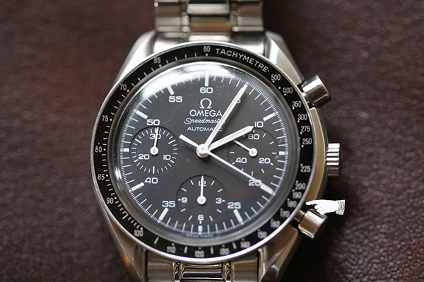 omega wristwatch close up of chronograph and tachymeter